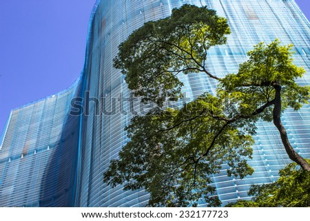 SAO PAULO, BRAZIL - NOVEMBER 18, 2014: Facade renovation of the Copan building in downtown Sao Paulo. Copan is the largest residential building in the world. - stock photo