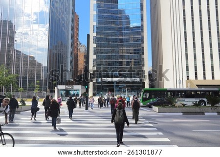 SAO PAULO, BRAZIL - OCTOBER 6, 2014: People visit Avenida Paulista avenue, Sao Paulo. With 21.2 million people Sao Paulo metropolitan area is the 8th most populous in the world. - stock photo