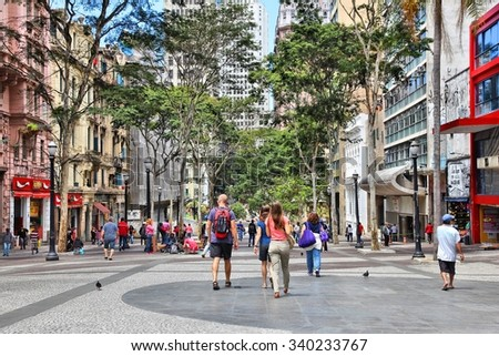 SAO PAULO, BRAZIL - OCTOBER 6, 2014: People visit downtown Sao Paulo. With 21.2 million people Sao Paulo metropolitan area is the 8th most populous in the world. - stock photo