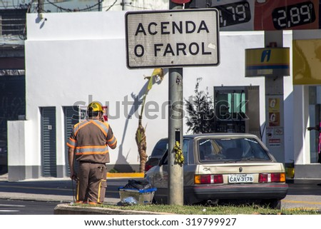 Sao Paulo, Brazil, September 22, 2015. Traffic agent controls drivers at avenue in south zone of Sao Paulo, Brazil - stock photo