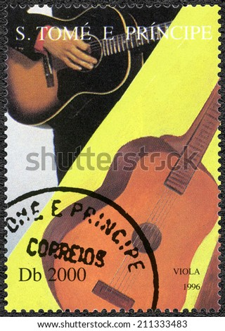SAO TOME AND PRINCIPE - CIRCA 1996: A stamp printed in Sao Tome and Principe shows Elvis Presley (1935-1977), circa 1996 - stock photo