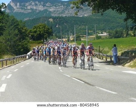 "SAOU, FRANCE - JUNE 11: Professional racing cyclists ride in the fifth stage time trial of the UCI World Tour, ""Criterum du Dauphine Libere"" on June 11, 2009 in Saou, Drome, France. - stock photo"