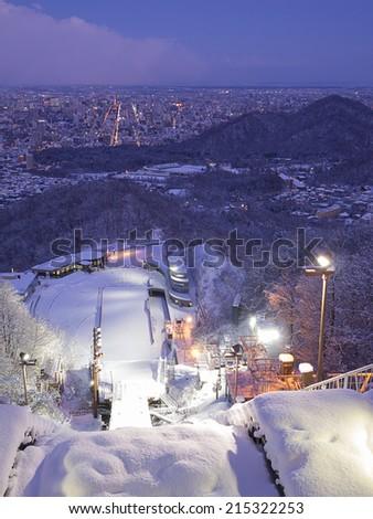 SAPPORO, JAPAN - DEC 12: Okurayama Ski Jump Stadium at night on December 12, 2011 in Sapporo, Japan. This stadium has hosted a number of winter sports events including 1972 Winter Olympics. - stock photo