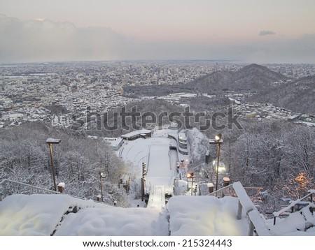 SAPPORO, JAPAN -DEC 12: Twilight at Okurayama Ski Jump Stadium Platform on December 12, 2011 in Sapporo, Japan. This stadium has hosted a number of winter sports events including 1972 Winter Olympics. - stock photo