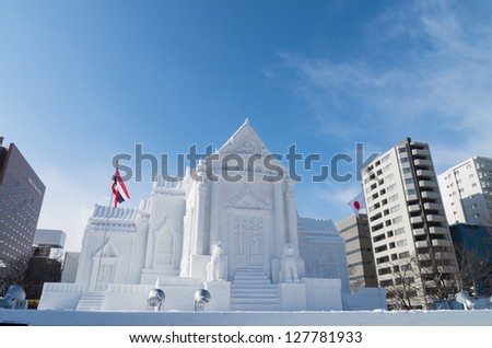 SAPPORO, JAPAN - FEB. 5 : Snow sculpture of Wat Benchamabophit at Sapporo Snow Festival site on February 5, 2013 in Sapporo, Hokkaido, japan. The Festival is held annually at Sapporo Odori Park. - stock photo
