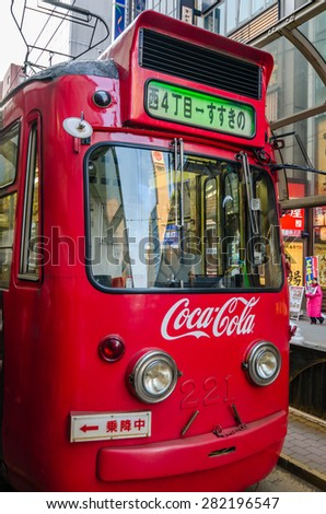 SAPPORO,JAPAN - 7 May 2014 :The Sapporo Streetcar is a tram network located in Sapporo, Hokkaido, Japan. It is operated by the Sapporo City Transportation Bureau.  - stock photo
