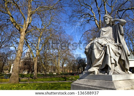 Sarah Siddons statue on Paddington Green with St.Mary's Church in the background, London. - stock photo