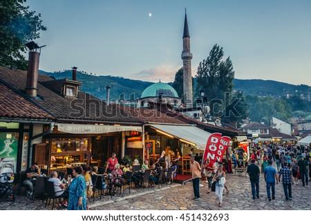 Sarajevo, Bosnia and Herzegovina - August 24, 2015. Tourists and local residents walks at main square of Bascarsija area in Sarajevo - stock photo