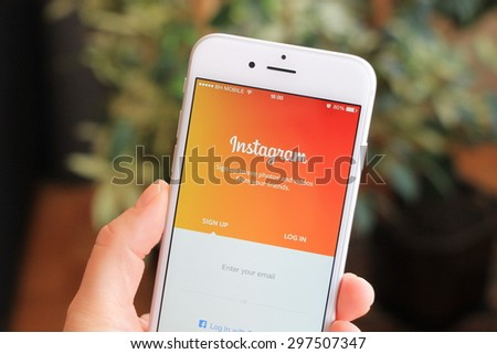 SARAJEVO , BOSNIA AND HERZEGOVINA - JULY 14, 2015: Woman trying to login to Instagram using Apple iPhone 6. Instagram is largest and most popular photograph social networking site in the world. - stock photo