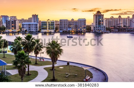 Sarasota skyline at dawn with orange sky - stock photo