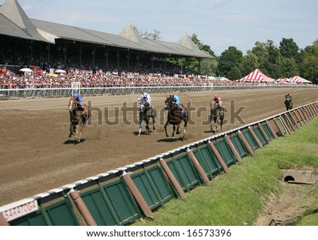 SARATOGA SPRINGS - August 17: Horses Heading down the Stretch at the end of the Third race August 17, 2008 in Saratoga Springs, NY. - stock photo