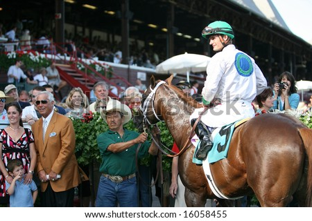 SARATOGA SPRINGS - August 9: Nautical Storm with Jamie Theriot aboard in the Winners Circle after the Eight Race August 9, 2008 in Saratoga Springs, NY. - stock photo