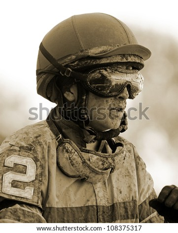 SARATOGA SPRINGS - JUL 21: Female Jockey Rosie Napravnik is covered in mud after competing in the Coaching Club American Oaks on Jul 21, 2012 at Saratoga Race Course in Saratoga Springs, NY. - stock photo