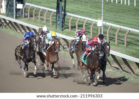 "SARATOGA SPRINGS, NY - August 18, 2014: ""Natalie Victoria"" with Jose Ortiz aboard leads after the start in the Summer Colony Stakes at Saratoga Race Course, August 18, 2014 Saratoga Springs, New York - stock photo"