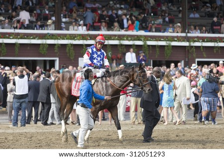 SARATOGA SPRINGS, NY - August 29, 2015: Runhappy ridden by Edgar Prado wins the King's Bishop Stakes on Travers Day at Historic Saratoga Race Course on August 29, 2015 Saratoga Springs, New York - stock photo