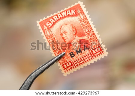 SARAWAK - CIRCA 1947: Orange color stamp printed in North Borneo (SARAWAK) with image of a SIR CHARLES VYNER BROOKE wirh a BMA(British Military Administrations) - stock photo