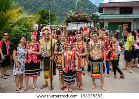 SARAWAK, MALAYSIA: JUNE 1, 2014: People of the Bidayuh tribe, an indigenous native people of Borneo, in traditional costumes, take part in a street parade to celebrate the Gawai Dayak festival. - stock photo