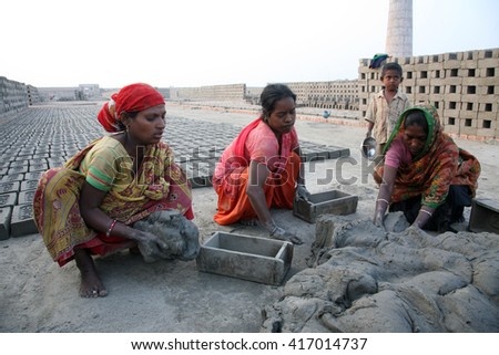 SARBERIA,INDIA, JANUARY 14: labourers prepare bricks at a brick kiln in Sarberia, West Bengal, India on January 14, 2009. The Indian brick industry is the second largest in the world after China. - stock photo