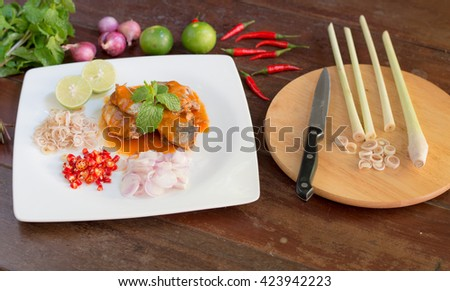 Sardines in Tomato Sauce Salad Thai-Style - stock photo