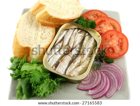 Sardines with bread, red onion, tomato, lettuce. and red basil. - stock photo