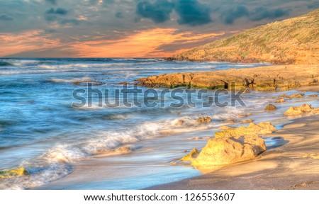 Sardinia coastline at sunset in hdr toning - stock photo