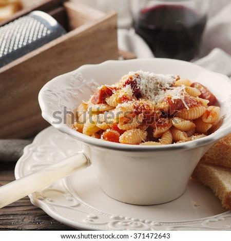 Sardinian traditional pasta malloreddus with sausage, selective focus and square image - stock photo