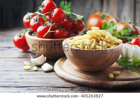 Sardinian uncooked pasta on the wooden table, selective focus - stock photo