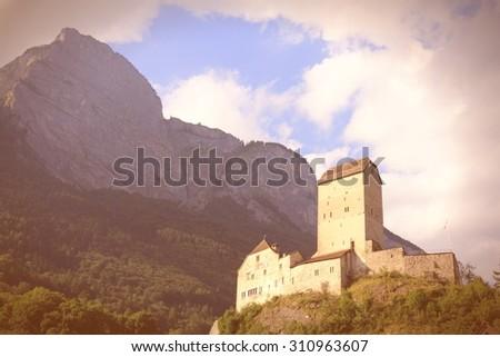 Sargans castle in Sarganserland region of canton St. Gallen. Alps in Switzerland. Retro filtered color style. - stock photo