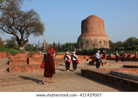 SARNATH,INDIA - MAR 08: Buddhist devotees come to offer prayers at the Buddhist monuments on March 08, 2016 in Sarnath,Uttar Pradesh, India.Sarnath is a Buddhist historical place and a pilgrim center. - stock photo