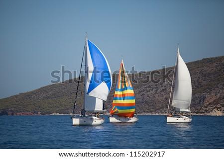 "SARONIC GULF, GREECE - SEPTEMBER 26: Competitors boats during of sailing regatta ""Viva Greece 2012"" on September 26, 2012 on Saronic Gulf, Greece. - stock photo"