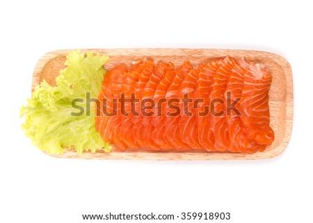 Sashimi salmon sliced in wood plate on white background - stock photo
