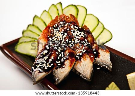 Sashimi Sushi with eel, cucumber, sesame seeds and sauce close-up - stock photo