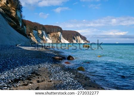 SASSNITZ, GERMANY - APRIL 3, 2015: High chalk cliffs at the coast of Rugen island, Jasmund National Park, Mecklenburg-Vorpommern, Germany - stock photo