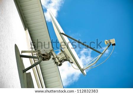 Satellite antenna on a house facade - stock photo