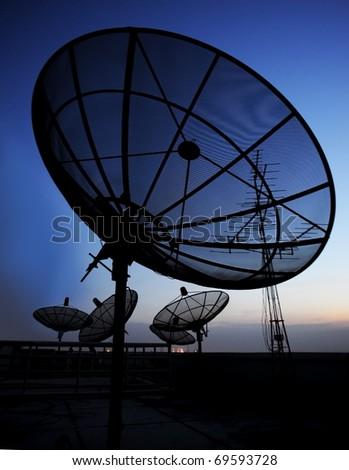 satellite communication disk on evening background - stock photo