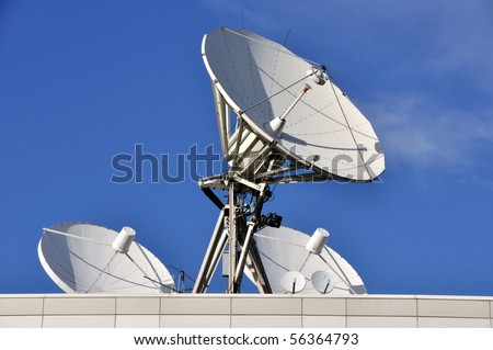 Satellite Communications Dishes on a Roof - stock photo