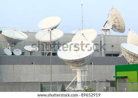 Satellite Communications Dishes on top of TV Station - stock photo