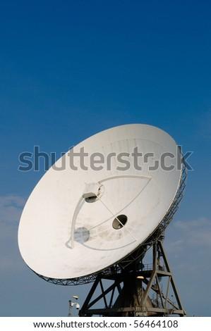 satellite disc against blue sky - stock photo