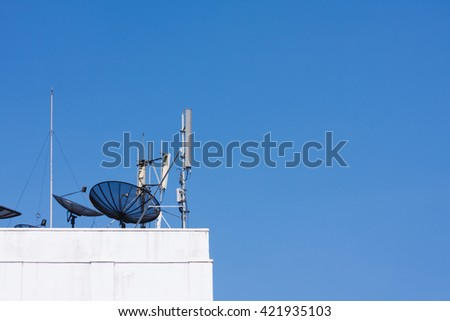 Satellite dish and antenna on the roof - stock photo