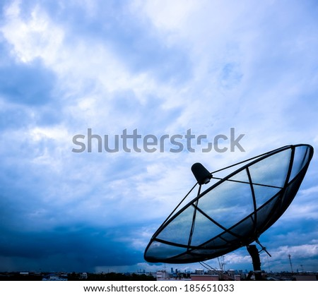 satellite dish and nimbus in the sky - stock photo