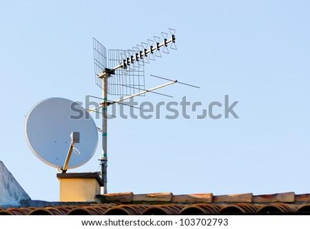 satellite dish and tv antenna - stock photo