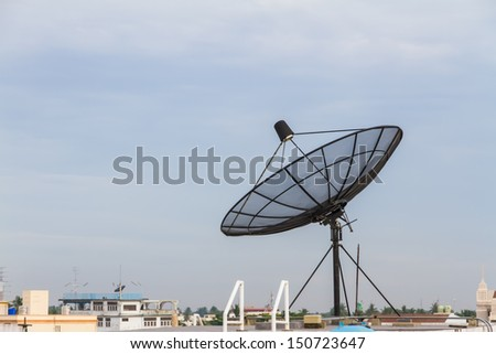 Satellite dish antenna on the roof. - stock photo