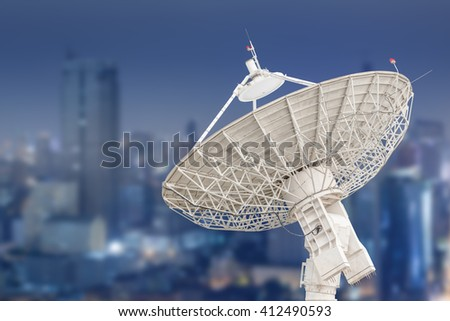 satellite dish antenna radar and building background - stock photo