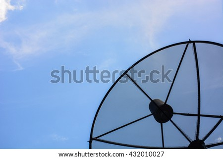 Satellite dish antennas in the bright day - stock photo