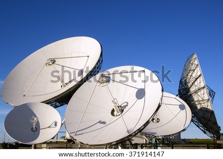 Satellite dish antennas with blue sky.Satellite dish antennas - stock photo