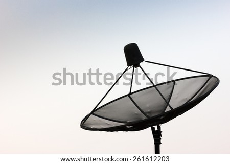 Satellite dish facing to extensive sky - stock photo