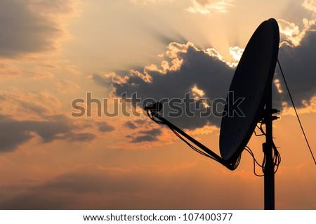 Satellite dish in contra light - stock photo