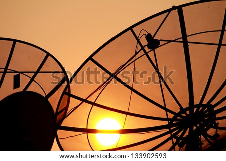 Satellite dish on sunset - stock photo