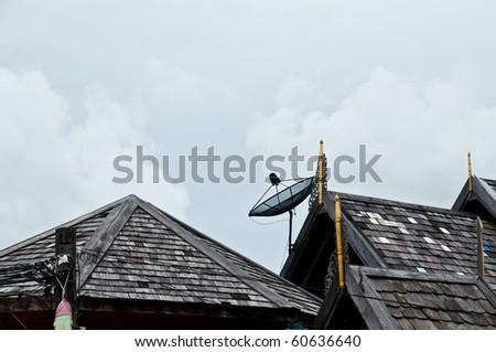 Satellite Dish on Thatch roof - stock photo