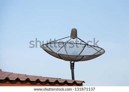 Satellite dish, receiver of television signals. Installed on the roof. - stock photo